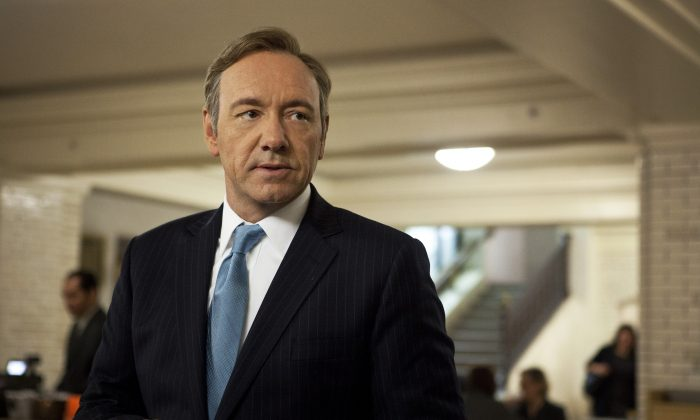"""This image released by Netflix shows Kevin Spacey as U.S. Congressman Frank Underwood in a scene from the Netflix original series, """"House of Cards."""" (AP Photo/Netflix, Melinda Sue Gordon)"""