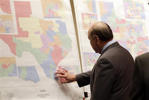 """Texas state Sen. Juan """"Chuy"""" Hinojosa looks at maps on display prior to a Senate Redistricting committee hearing in Austin, Texas, on May 30, 2013. (AP Photo/Eric Gay, File)"""