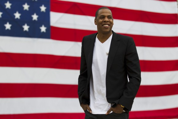 """Shawn """"Jay-Z"""" Carter smiles after a news conference at the Philadelphia Museum of Art in Philadelphia. (AP Photo/Matt Rourke, File)"""