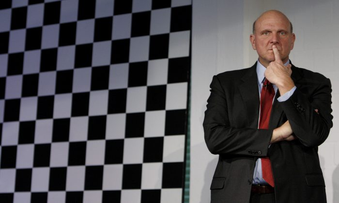 Steve Ballmer, CEO of Microsoft, follows a news conference in Germany in this file photo. Ballmer is set to retire within 12 months, but his legacy is marred by blunders. (AP Photo/Matthias Schrader)