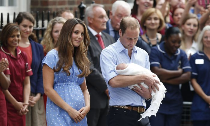 This July 23, 2013 file photo shows Britain's Prince William, right, and Kate, Duchess of Cambridge with their first baby Prince George outside St. Mary's Hospital in London. (AP Photo/Sang Tan, File)