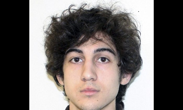 Boston Marathon bombing suspect Dzhokhar Tsarnaev, who faced arraignment in federal court Wednesday, July 10, 2013 in Boston. The 19-year-old has been charged with using a weapon of mass destruction, and could face the death penalty. (AP Photo/Federal Bureau of Investigation, File)