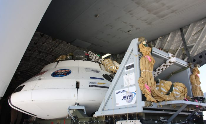 The Orion test capsule is readied for a test on July 24, 2013. NASA and the U.S. Army are test dropping it from a plane flying at 35,000 feet to evaluate how its parachutes perform. (NASA)