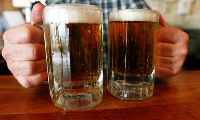 A bartender serves two mugs of beer at a tavern in Montpelier, Vermont, in this file photo. (AP Photo/Toby Talbot)