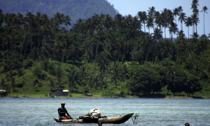 Residents fish on the island of New Britain, Papua New Guinea near Kimbe Bay on Nov. 28, 2007. Papua New Guinea is part of New Guinea, the second-largest island in the world. (David Longstreath/AP)