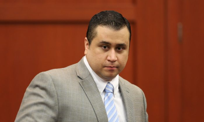 George Zimmerman arrives for day 23 of his trial in Seminole circuit court in Sanford, Fla. Thursday, July 11, 2013. Zimmerman has been charged with second-degree murder for the 2012 shooting death of Trayvon Martin. (Gary W. Green/Orlando Sentinel)