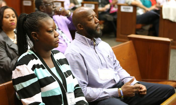 The parents of Trayvon Martin, Sybrina Fulton, left, and Tracy Martin, listen to testimony of a witness during the 15th day of George Zimmerman's trial in Seminole circuit court, in Sanford, Fla., Friday, June 28, 2013. They said on July 19 that President Barack Obama's words were inspirational. (AP Photo/Orlando Sentinel, Joe Burbank, Pool)