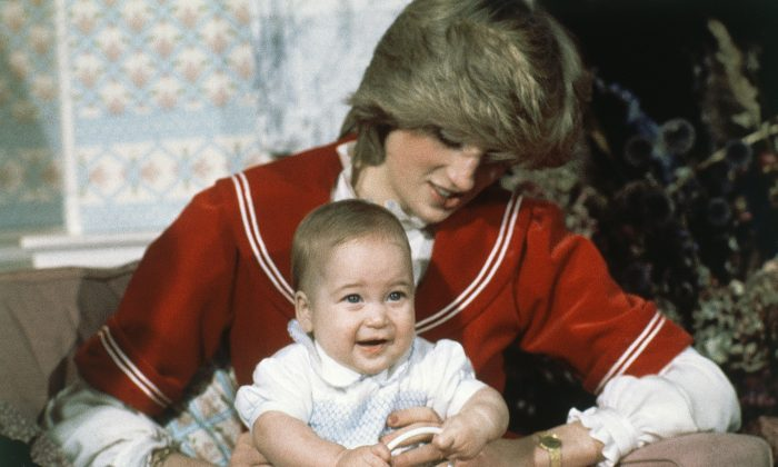 Prince William, 6-month old son of British Prince Charles and Princess Diana, with his proud parents during a special picture call at Kensington Palace in London on Dec. 22, 1982. (AP Photo/David Caulkin)