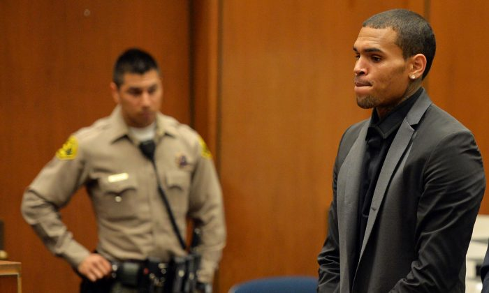 R&B singer Chris Brown appears during a court hearing at Los Angeles Superior court in Los Angeles, July 15, 2013. A Los Angeles judge has revoked Chris Brown's probation after reading details of an alleged hit-and-run accident and his behavior afterward, but the singer was not ordered to jail. The prosecutor did not ask for Brown to be jailed. Another hearing is set for Aug. 16. The singer has been on felony probation in the 2009 beating of former girlfriend Rihanna. (AP Photo/Alberto E. Rodriguez)