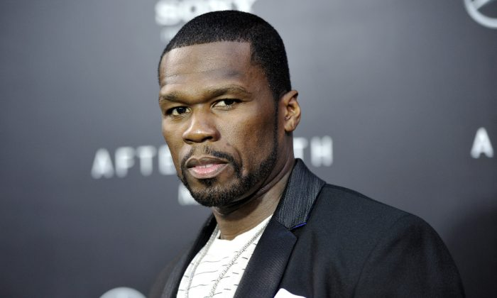 """Rapper Curtis """"50 Cent"""" Jackson attends the """"After Earth"""" premiere at the Ziegfeld Theatre, in New York, May 29, 2013. Jackson has been charged with attacking his ex-girlfriend and trashing her Los Angeles condo last month. City Attorney Mike Feuer said Wednesday, July 3, 2013, the 37-year-old """"In da Club"""" singer is charged with domestic violence and vandalism. (Photo by Evan Agostini/Invision/AP)"""