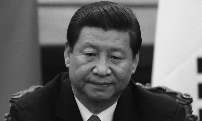 In this file photo Secretary General Xi Jinping is pictured in the Great Hall of the People in Beijing on June 27, 2013. Xi's political and ideological tightening may end up clashing with the economic reforms that are currently being attempted. (Wang Zhao/AFP/Getty Images)