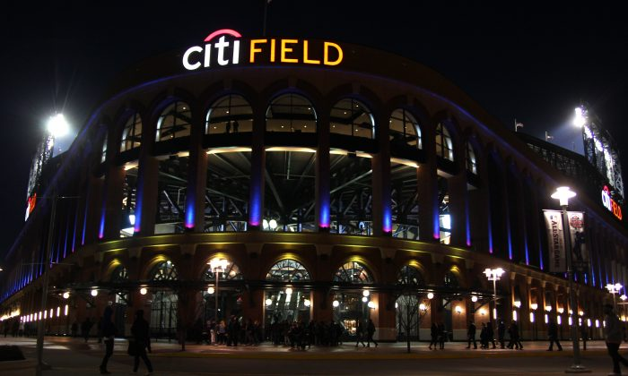 Fans come and go from Citi Field during a baseball game between the New York Mets and Miami Marlins on Friday, April 5, 2013, in New York. (Peter Morgan/AP Photo)