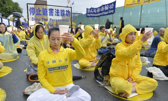 Falun Gong practitioners protest outside the Chinese Consulate in New York on July 20, the day the persecution of Falun Gong started 14 years ago. (Edward Dai/Epoch Times)