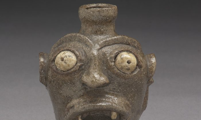A small stoneware jug, unique among Edgefield face jugs, roars its defiance in the face of slavery. Such art preserved Kongo religious and spiritual beliefs in a coded form beyond the understanding of white Southern planters. (Courtesy The Chipstone Foundation)