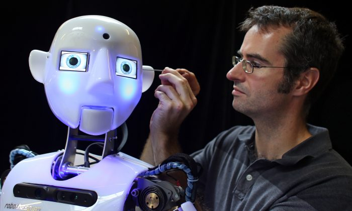 Engineered Arts design and production engineer Marcus works on a nearly completed RoboThespian robot on July 30, 2013 in Penryn, England. The Cornish company is the world's only maker of commercially available life-sized humanoid robots.  (Matt Cardy/Getty Images)