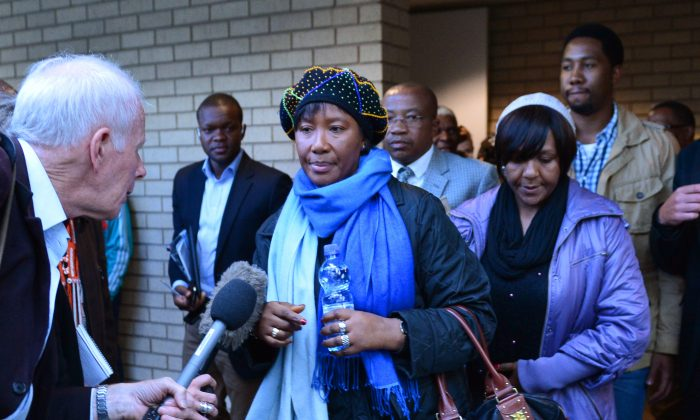 Makaziwe Mandela (C), daughter of Nelson Mandela, followed by Ndileka Mandela (C) and Ndaba (back R), the grandchildren of Mandela, leave the Mthatha high court on July 3, 2013. Nelson Mandela, who succeeded at battling rampant racism in the country, has had his final days become another struggle amidst warring family members. (Carl De Souza/AFP/Getty Images)