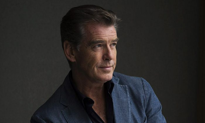 "This Sept. 9, 2012 file photo shows actor Pierce Brosnan during a photo shoot to promote the movie ""Love is All You Need"" at the 2012 Toronto International Film Festival in Toronto. (AP Photo/The Canadian Press, Michelle Siu)"