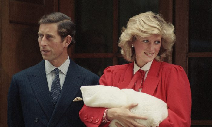 In this Sept. 16, 1984 file photo, Britain's Prince Charles, left, and Princess Diana leave St. Mary's Hospital in Paddington, London with their new baby son, Prince Harry.  (AP Photo)