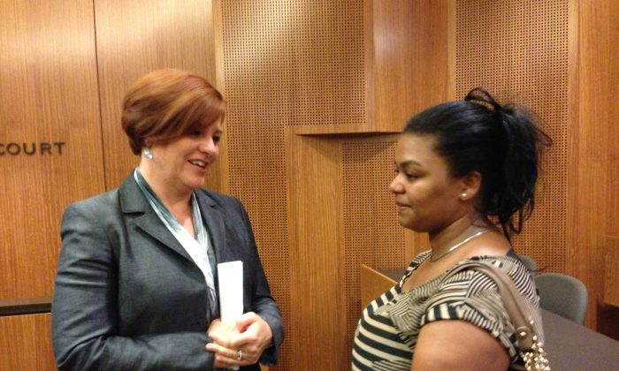 New York City Council Speaker Christine Quinn speaks to Perla Rodriguez Vasquez at the Cardozo School of Law in Manhattan on July 19, 2013. Rodriguez Vasquez's brother is currently detained by immigration authorities. Quinn announced the designation of $500,000 in city council funding towards legal services for detained immigrants facing deportation. (Ivan Pentchoukov/Epoch Times)