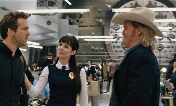 """(L-R) Nick (played by Ryan Reynolds), Proctor (played by Mary-Louise Parker) and Roy (played by Jeff Bridges) in the action-adventure """"R.I.P.D.,"""" a film about Bridges and Reynolds who play two cops dispatched by an otherworldly Rest In Peace Department to protect and serve the living from an increasingly destructive array of creatures who refuse to move into the afterlife peacefully. (Courtesy of Universal Studios)"""