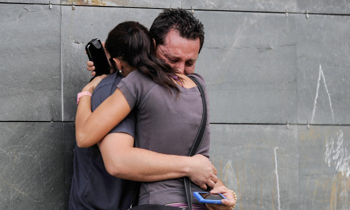 Relatives of passengers involved in the train crash comfort each other as they wait for news at the Cersia Building in Santiago de Compostela, Spain, on July 25, 2013. (David Ramos/Getty Images)