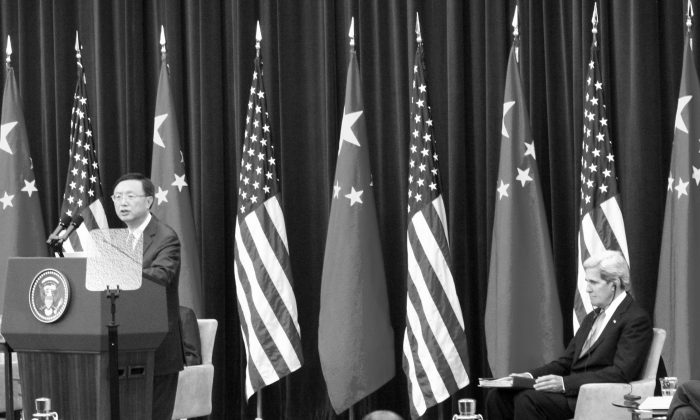 Yang Jiechi, state councilor of the People's Republic of China, addressed the crowd with John Kerry, U.S. secretary of state, looking on, at the U.S.-China Strategic & Economic Dialogue being held in Washington on July 10 and 11. (Matthew Robertson/Epoch Times)