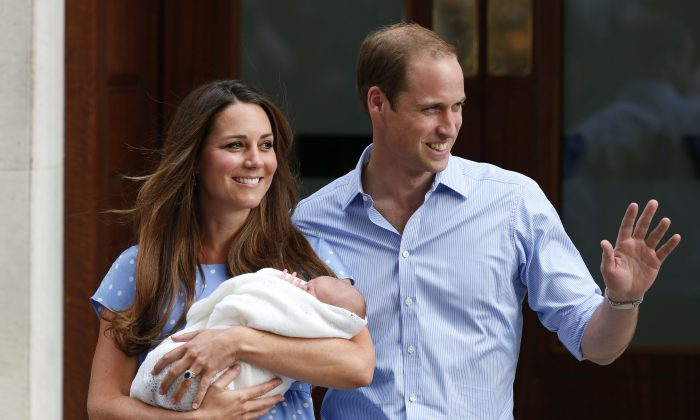 Britain's Prince William and Kate, Duchess of Cambridge hold the Prince of Cambridge, Tuesday July 23, 2013, as they pose for photographers outside St. Mary's Hospital exclusive Lindo Wing in London where the Duchess gave birth on Monday July 22. (AP Photo/Lefteris Pitarakis)