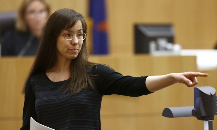 In this May 21, 2013 file photo, Jodi Arias points to her family as a reason for the jury to give her a life in prison sentence instead of the death penalty, during the penalty phase of her murder trial at Maricopa County Superior Court in Phoenix. (AP Photo/The Arizona Republic, Rob Schumacher, Pool)