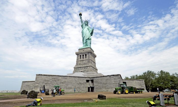 National Park Service workers on June 26, 2013 Liberty Island install sod around the Statue of Liberty national monument set to re-open on the 4th of July. (AP Photo/National Park Service,
