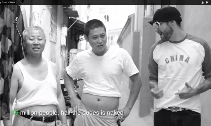 """A screengrab of the American expatriate rapper saying, """"15 million people, half the dudes is naked, Pullin' up their shirts, cause the summers they can't take it,"""" in a song called """"Beijing State of Mind"""" that parallels the original Jay-Z and Alicia Keys' hit, """"Empire State of Mind."""" (YouTube via Mark Griffith)"""