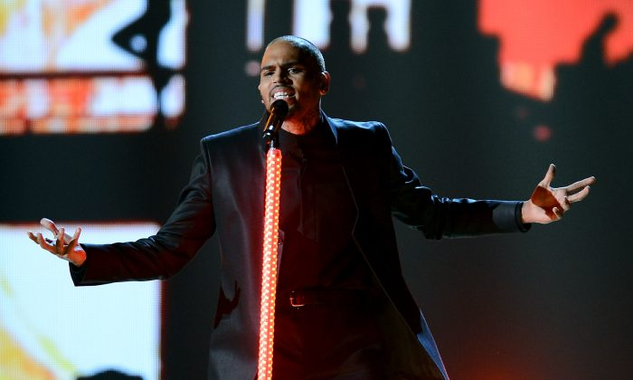 R&B singer Chris Brown performs during the 2013 Billboard Music Awards on May 19, 2013, in Las Vegas. More than 12,000 people have signed a petition to stop Brown from performing in Halifax, Nova Scotia, next month. (Photo by Ethan Miller/Getty Images)