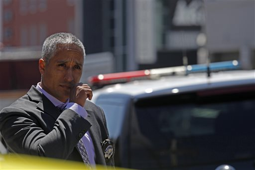 San Francisco Police Sgt. David Almaguer patrols the scene of a shooting in San Francisco on Friday, July 12, 2013. (AP Photo/San Francisco Chronicle, Katie Meek)