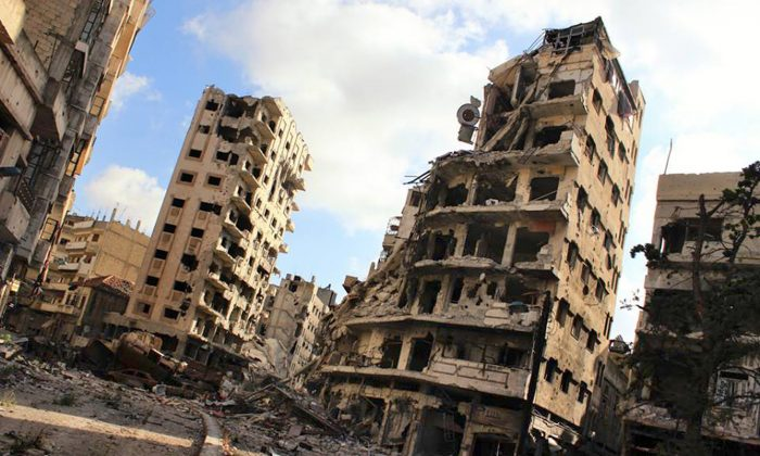 Buildings damaged by Syrian government airstrikes and shelling, in the Jouret al-Chiyah neighborhood of Homs, Syria, on July 3, 2013. (Lens Young Homsi/AP Photo)
