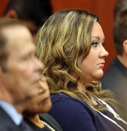 Shellie Zimmerman, wife of George Zimmerman, watches her husband arrive in the courtroom during his trial at the Seminole County Criminal Justice Center, in Sanford, Fla., Friday, July 12, 2013.  Zimmerman is charged in the 2012 shooting death of unarmed teenager Trayvon Martin. (AP Photo/Orlando Sentinel, Joe Burbank, Pool)