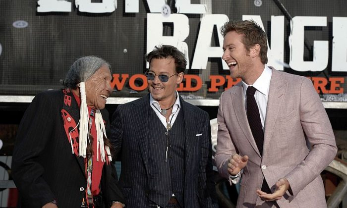"Actors Saginaw Grant, Johnny Depp, and Armie Hammer arrive at the premiere of ""The Lone Ranger"" at Disney California Adventure Park on June 22 in Anaheim, Calif. (Kevin Winter/Getty Images)"