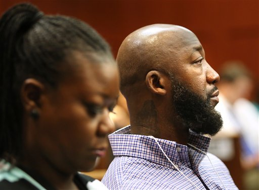 The parents of Trayvon Martin, Sybrina Fulton, left, and Tracy Martin, listen to the 911 phone call of the shooting of their son by George Zimmerman, during the 15th day of Zimmerman's trial in Seminole circuit court, in Sanford, Fla., Friday, June 28, 2013. Zimmerman was  charged with second-degree murder for the 2012 shooting death of Trayvon Martin, but was later acquitted. (AP Photo/Orlando Sentinel, Joe Burbank, Pool)