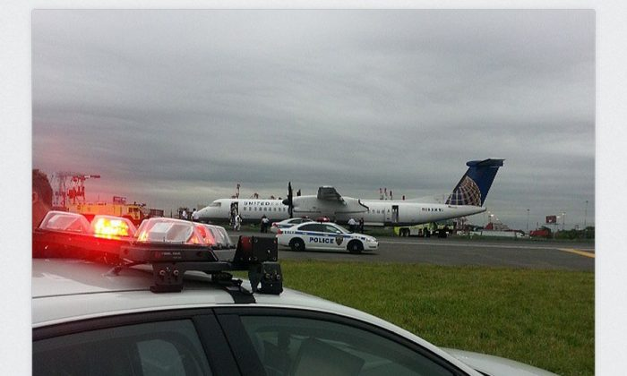 A screenshot of user albo13harrison's account shows the plane on the ground at Newark airport.