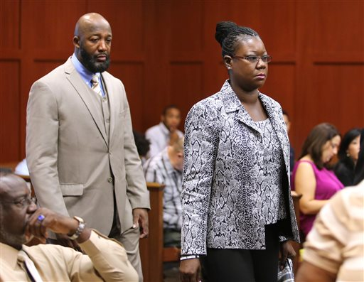 The parents of Trayvon Martin, Tracy Martin and Sybrina Fulton, arrive at the trial for George Zimmerman in Seminole Circuit Court, in Sanford, Fla., Tuesday, July 9, 2013. Zimmerman is charged with second-degree murder in the fatal shooting of Trayvon Martin, an unarmed teen, in 2012. (AP Photo/Orlando Sentinel, Joe Burbank, Pool)