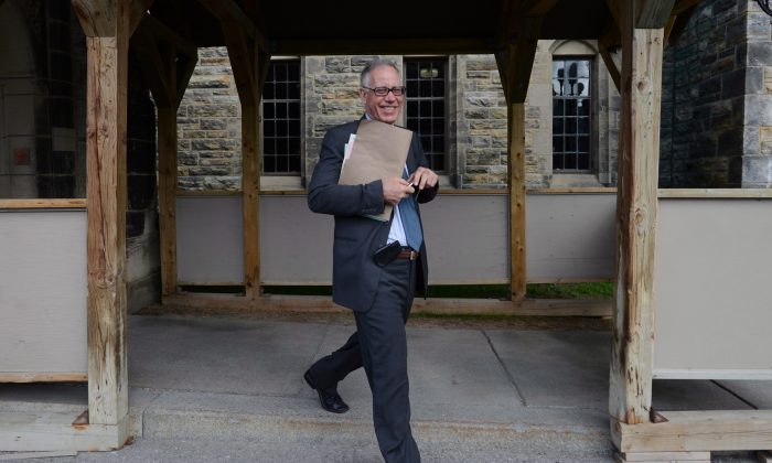 Sen. Mac Harb leaves the Parliament Buildings after attending a meeting on May 9. An Ottawa businessman's $55,000 loan to Harb is raising fresh questions in the Senate ethics scandal. (The Canadian Press/Sean Kilpatrick)