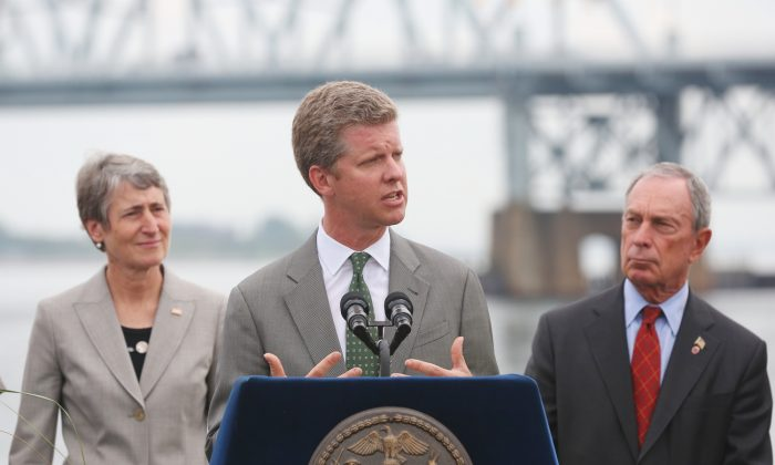 Housing and Urban Development Secretary Shaun Donovan speaks at a press conference at Riis Landing on the Rockaway Peninsula on Aug. 12. To his left is Secretary of the Interior Sally Jewell, and to his right is Mayor Michael Bloomberg. (Gary Du/Epoch Times)