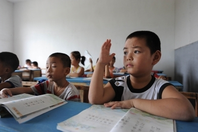 """Chinese elementary school students learning a language. Chinese parents can be relentless when it comes to filling their children's schedule with extra-curriculuar activities, so their children can """"win at the starting line."""" (Getty Images)"""