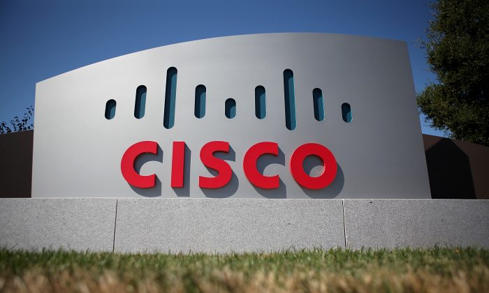 A sign is posted in front of the Cisco Systems headquarters on August 10, 2011 in San Jose, California. (Photo by Justin Sullivan/Getty Images)