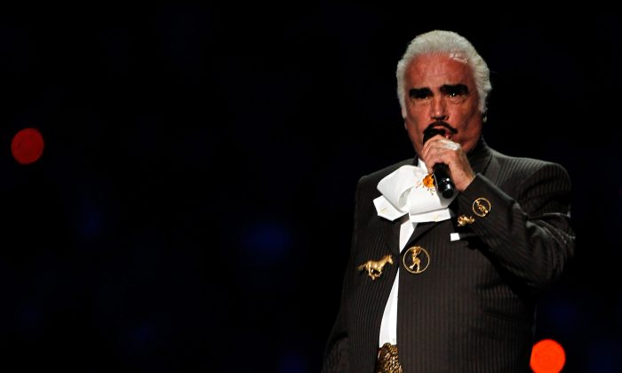 Singer Vicente Fernandez performs to start the Opening Ceremony for the XVI Pan American Games at Omnilife Stadium on October 14, 2011 in Guadalajara, Mexico.  The famous singer is currently hospitalized with pulmonary thrombosis. (Mike Ehrmann/Getty Images)