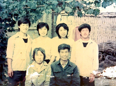 Pictured are the six members of the family of Chen Yunchuan, five of whom have died as a result of the persecution of Falun Gong in China. Chen Shulan, second from the right in the back, recently suffered two spinal fractures after being detained and is said to be unable to walk. (Minghui.org)