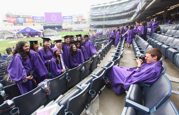 Graduates pose after New York University's commencement ceremony at Yankee Stadium on May 16, 2012, in the Bronx borough of New York City. U.S. Supreme Court Justice Sonia Sotomayor spoke to a crowd of more than 27,000 at the ceremony. (Photo by Mario Tama/Getty Images)