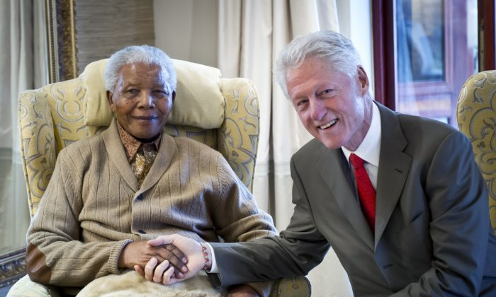 In this July 2012 file photo, former South African President Nelson Mandela is with former U.S. President Bill Clinton on the eve of his 94th birthday at his residence in Qunu, South Africa. The office of current South African President Jacob Zuma said on September 1, 2013 that Mandela was released from the hospital. (Barbara Kinney/Clinton Foundation via Getty Images)