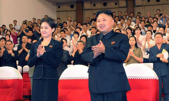 North Korean leader Kim Jong Un (C), accompanied by wife Ri Sol-Ju on July 6, 2012.(KNS/AFP/GettyImages)