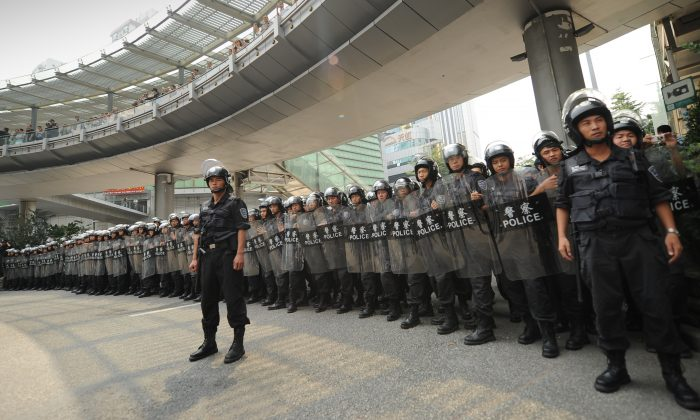 Riot police stand guard as anti-Japan protesters march during a protest over the Diaoyu islands issue, known as the Senkaku islands in Japan, in the southern Chinese city of Shenzhen on Sept. 18, 2012.  (PeterParks/AFP/Getty Images)