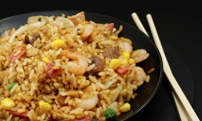 Although Chinese food experts say that fried rice is a specialty of Yangzhou, they don't put an exact date as to the beginnings of this dishes origin.(Stock Solutions/Photos.com)