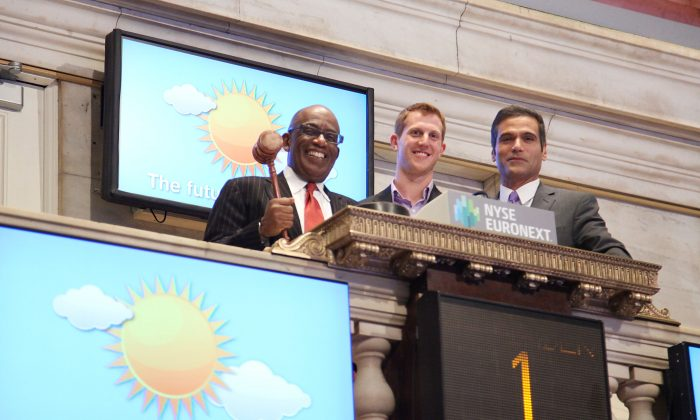 Al Roker (L) and Chris Cimino (R) of NBC visit the New York Stock Exchange on November 1, 2012 in New York City.  (Photo by Rob Kim/Getty Images)
